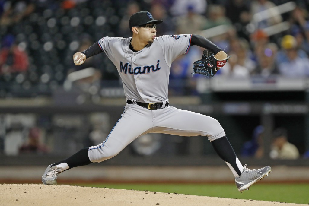 Miami Marlins starting pitcher Robert Dugger winds up during the first inning of the team's baseball game against the New York Mets, Wednesday, Sept. ...