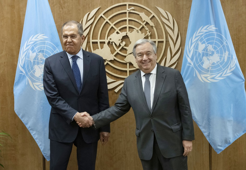 In this photo provided by the United Nations, Sergey V. Lavrov, left, Minister for Foreign Affairs of the Russian Federation, shakes hands with U.N. S
