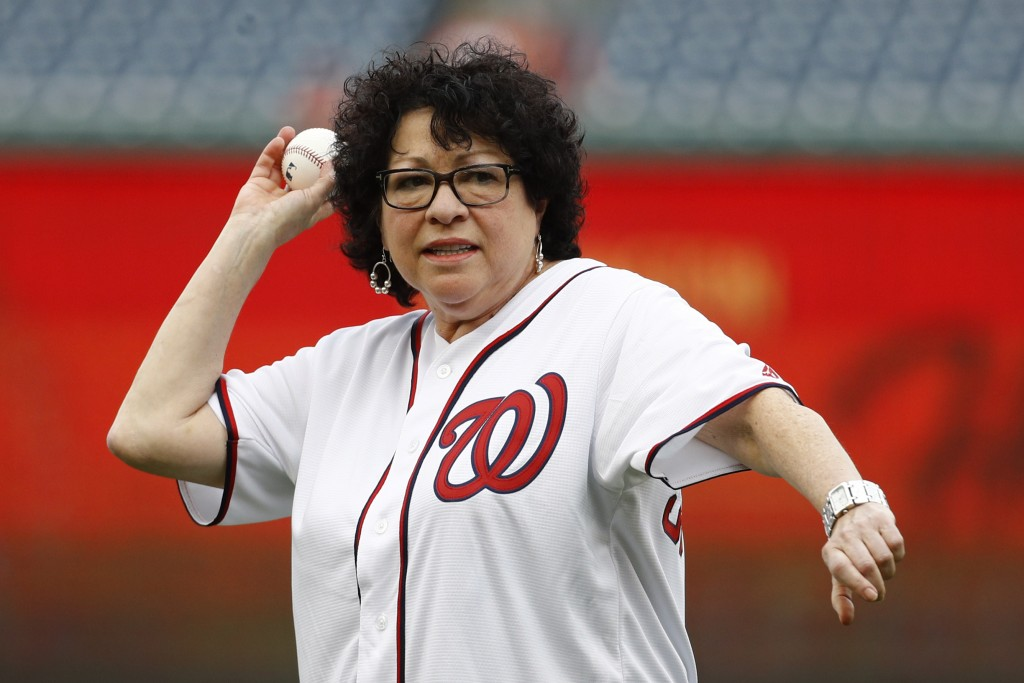 Supreme Court Associate Justice Sonia Sotomayor throws out a ceremonial first pitch before a baseball game between the Philadelphia Phillies and the W...