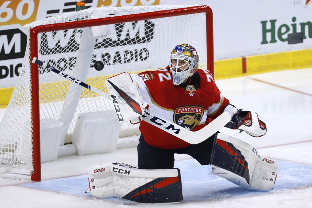 Florida Panthers goaltender Sergei Bobrovsky deflects a shot during the second period of the team's preseason NHL hockey game against the Tampa Bay Li...