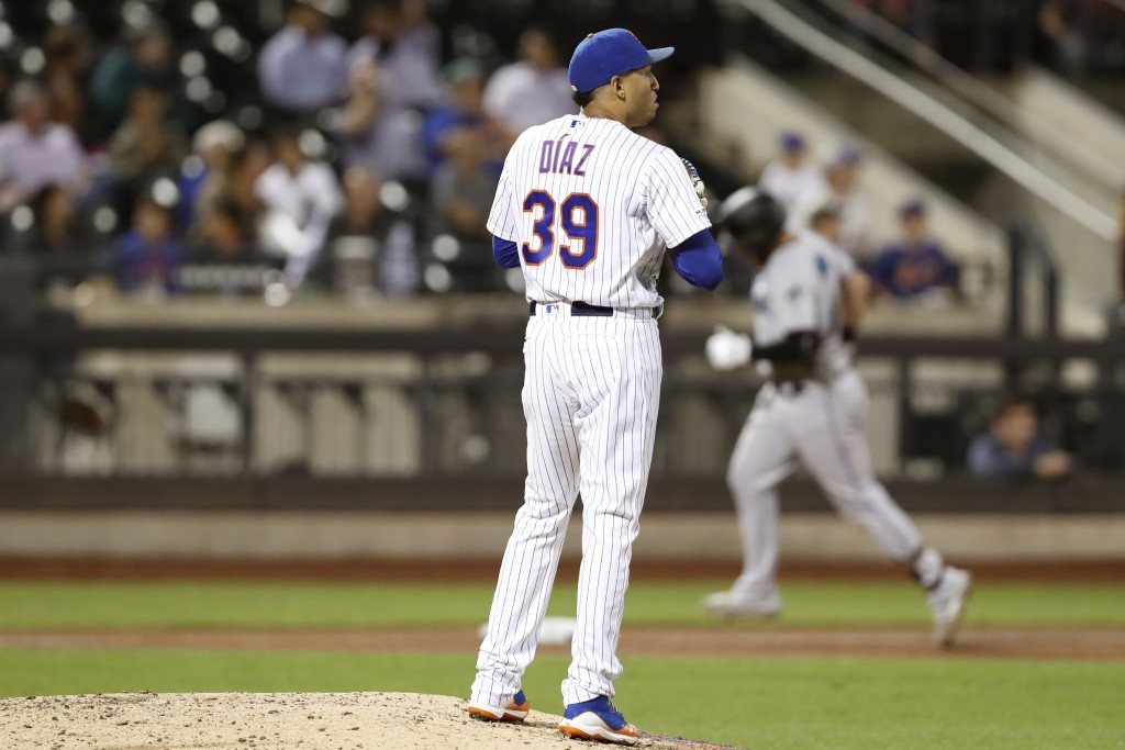 New York Mets relief pitcher Edwin Diaz (39) looks away as Miami Marlins' Austin Dean rounds the bases, back right, after hitting a solo home run duri...