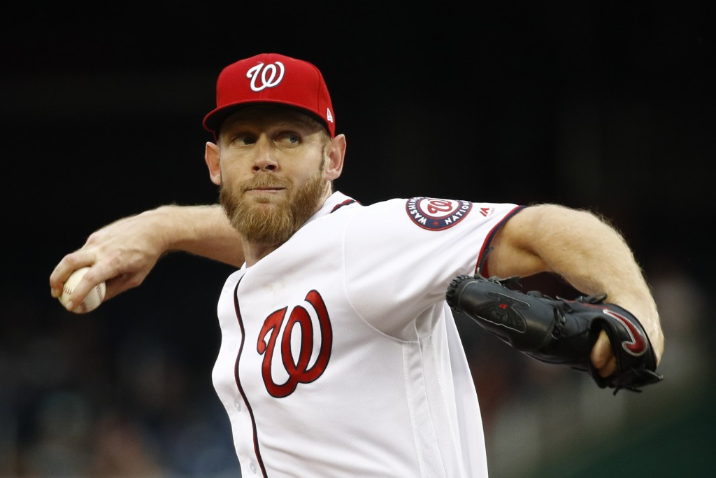 Washington Nationals starting pitcher Stephen Strasburg throws to the Philadelphia Phillies in the third inning of a baseball game, Thursday, Sept. 26...