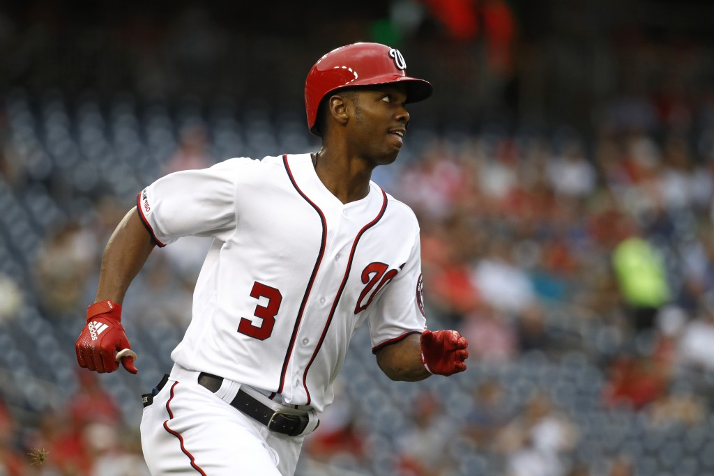 Washington Nationals' Michael A. Taylor watches his solo home run as he rounds the bases in the second inning of a baseball game against the Philadelp...
