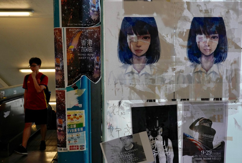 Posters of a girl wearing an eye patch, a symbol of the fight for freedom after a young woman sustained a severe eye injury during an anti-government ...