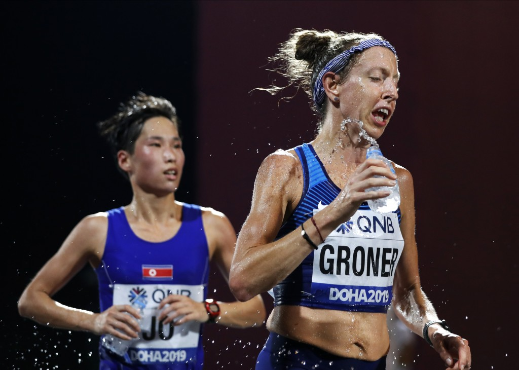 Roberta Groner, of the United States, pours water on herself during the women's marathon at the World Athletics Championships in Doha, Qatar, Saturday