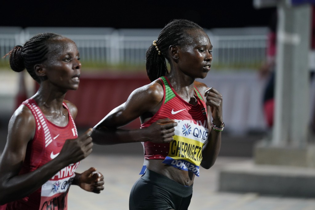 Ruth Chepngetich, of Kenya, right, leads Rose Chelimo, of Bahrain, during the women's marathon at the World Athletics Championships in Doha, Qatar, Sa...