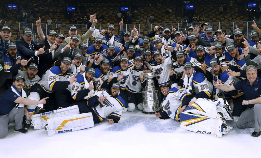 FILE - In this June 12, 2019, file photo, the St. Louis Blues celebrate with the Stanley Cup after they defeated the Boston Bruins in Game 7 of the NH...