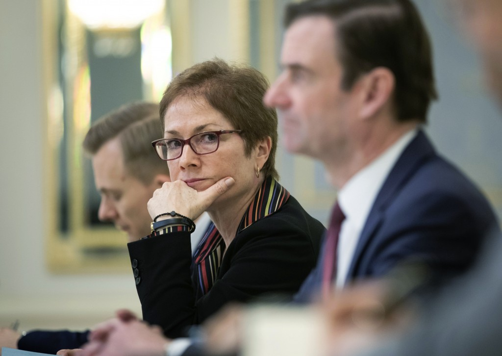 FILE - In this March 6, 2019 file photo, then U.S. Ambassador to Ukraine Marie Yovanovitch, center, sits during her meeting with Ukrainian President P