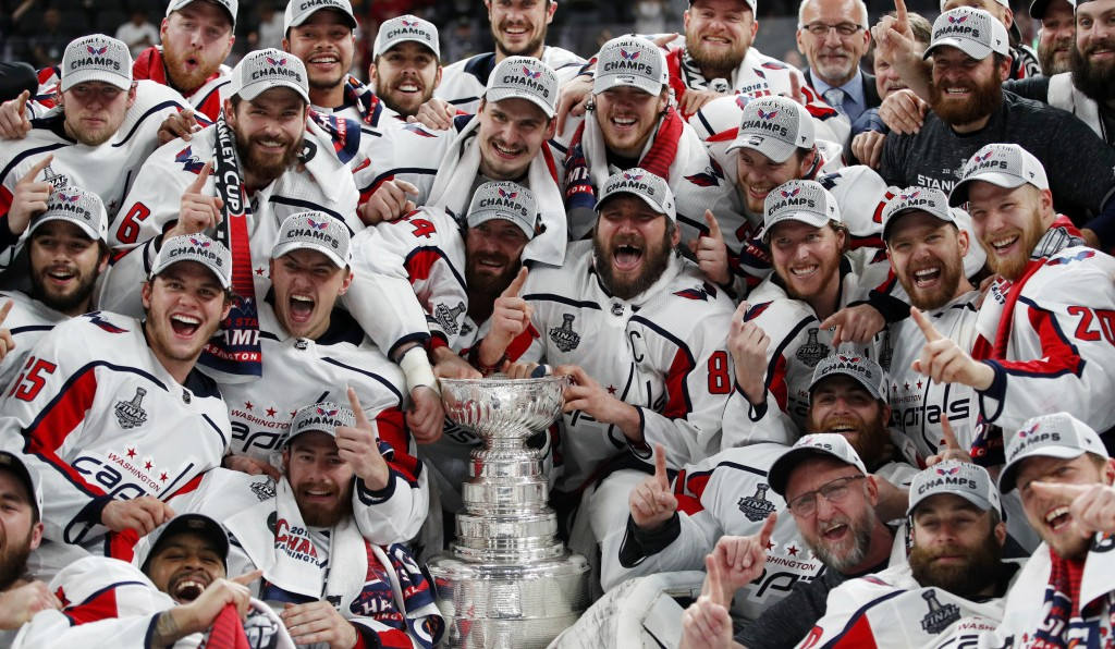 FILE - In this June 7, 2018, file photo, members of the Washington Capitals pose with the Stanley Cup after the Capitals defeated the Golden Knights 4...