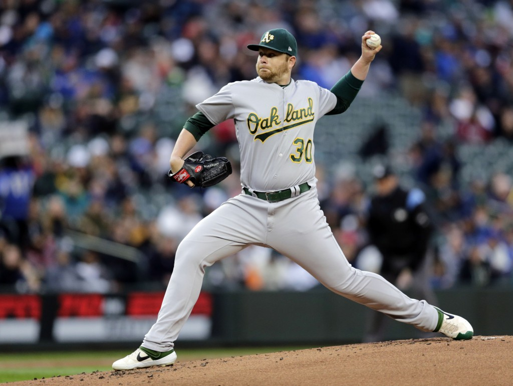 Oakland Athletics starting pitcher Brett Anderson works against the Seattle Mariners during the first inning of a baseball game, Saturday, Sept. 28, 2...