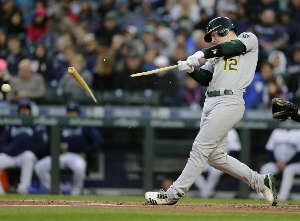 Oakland Athletics' Sean Murphy breaks a bat on a pitch from Seattle Mariners' Marco Gonzales during the second inning of a baseball game, Saturday, Se...