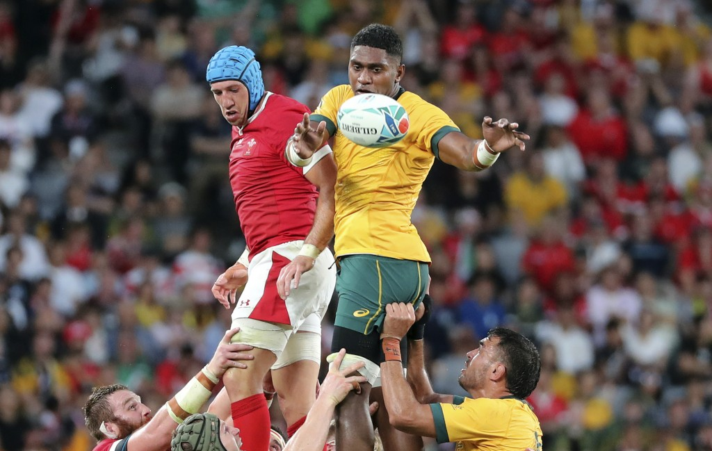Wales Justin Tipuric, left, and Australia's Isi Naisarani jump to win a lineout ball during the Rugby World Cup Pool D game at Tokyo Stadium between A...