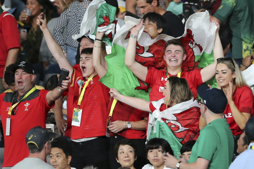 Wales fans celebrate after the Rugby World Cup Pool D game at Tokyo Stadium between Australia and Wales in Tokyo, Japan, Sunday, Sept. 29, 2019. (AP P...