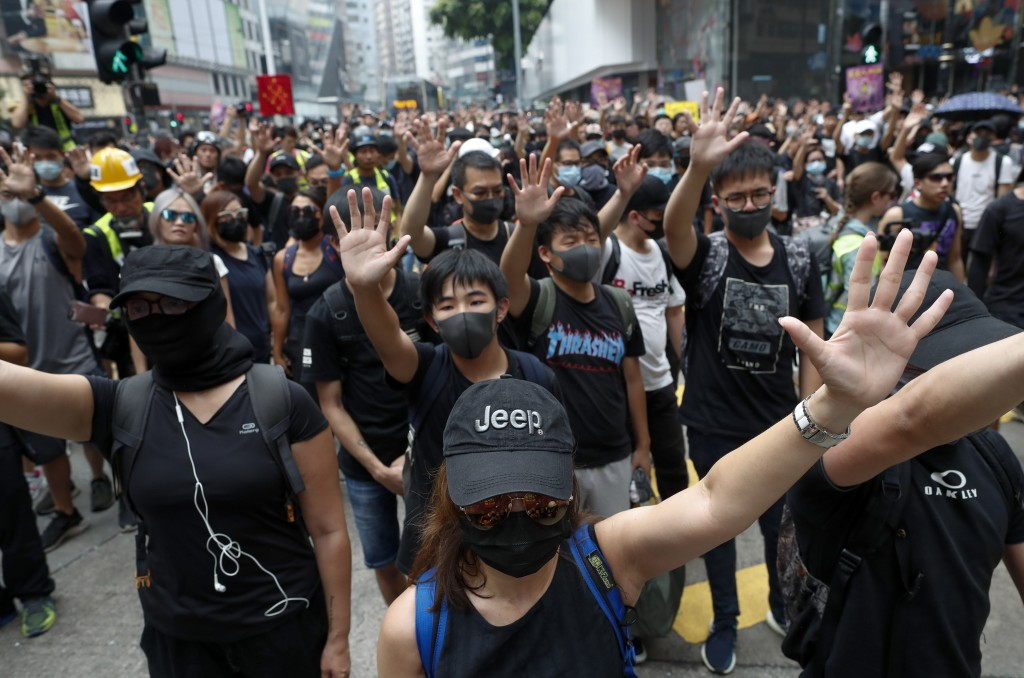 Protestors shout slogans in Hong Kong, Sunday, Sept. 29, 2019. Protesters and police clashed in Hong Kong for a second straight day on Sunday, throwin...