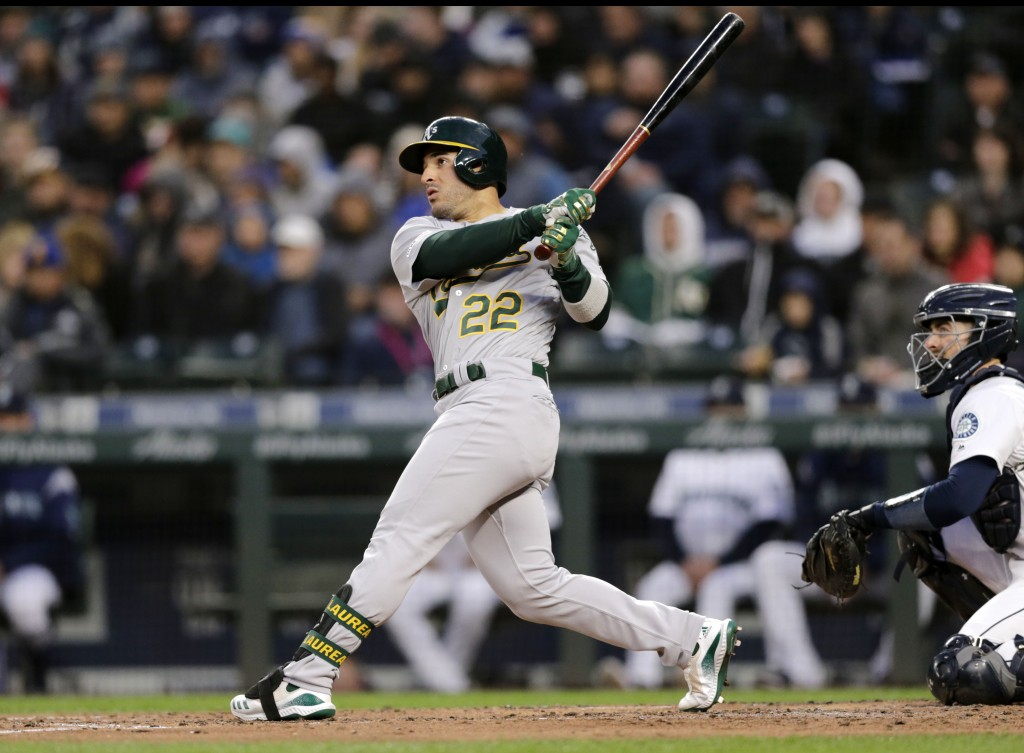 Oakland Athletics' Ramon Laureano hits a solo home run on a pitch from Seattle Mariners starting pitcher Marco Gonzales during the third inning of a b...