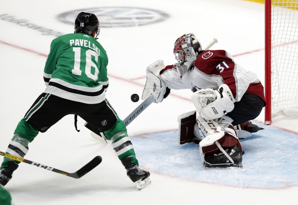 Dallas Stars center Joe Pavelski (16) has his shot blocked by Colorado Avalanche goaltender Philipp Grubauer (31) in the second period of a preseason