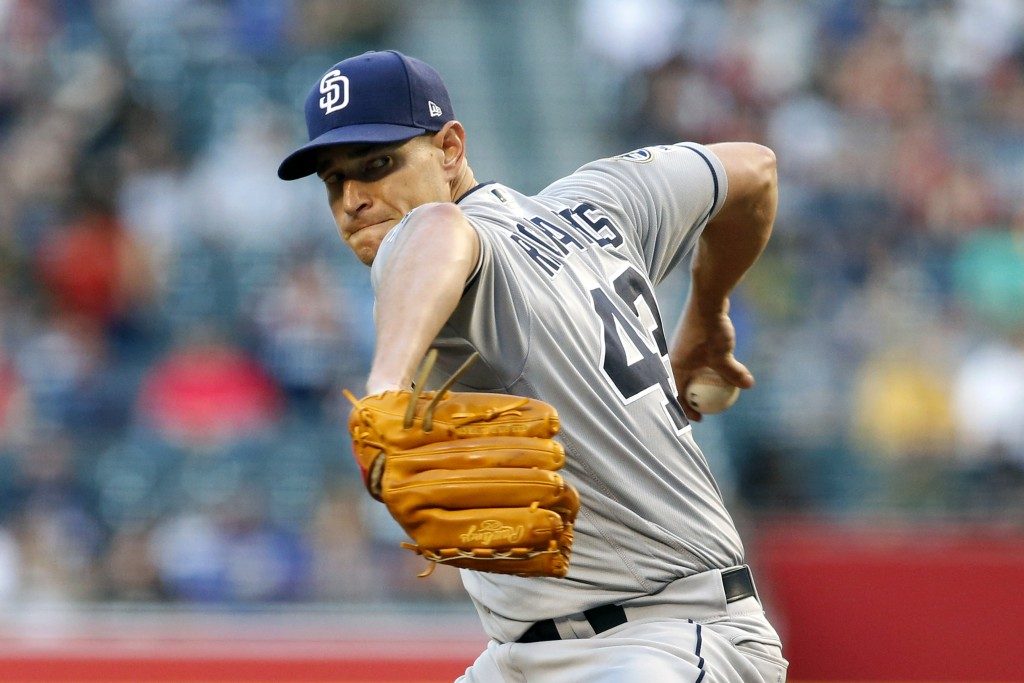 San Diego Padres starting pitcher Garrett Richards throws against the Arizona Diamondbacks during the first inning of a baseball game, Saturday, Sept....