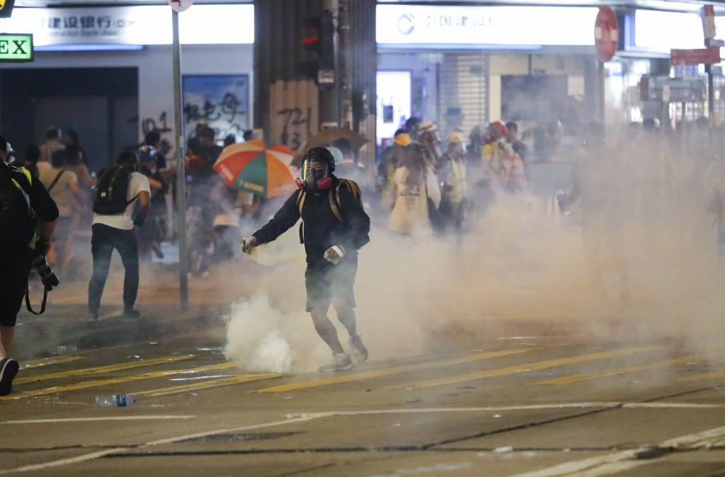 Police use tear smoke at protestors in Hong Kong, Sunday, Sept. 29, 2019. Protesters and police clashed in Hong Kong for a second straight day on Sund...