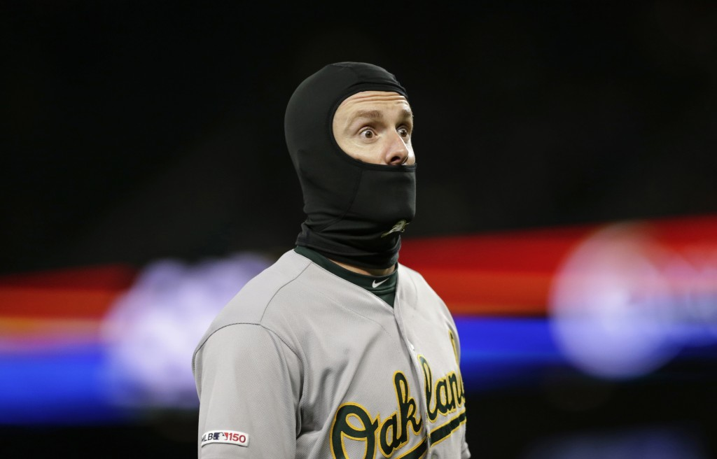 Oakland Athletics' Mark Canha reacts while walking to the dugout after the final out of the middle of the sixth inning against the Seattle Mariners du...