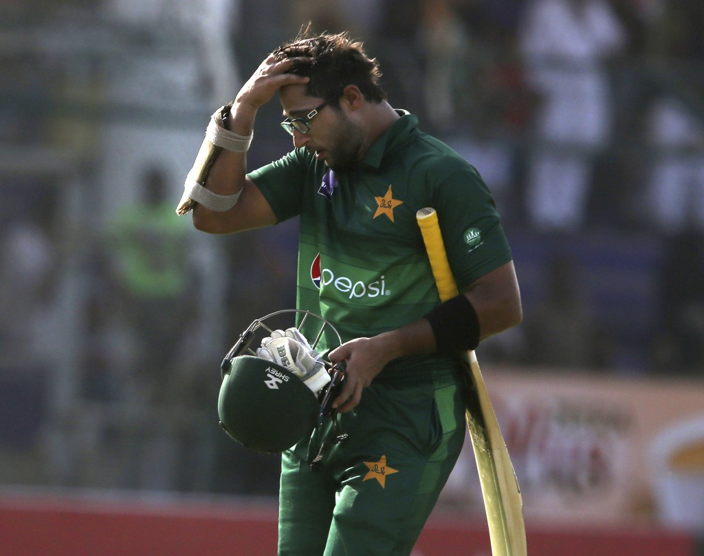 Pakistan's Imam-ul-Haq on his way to pavilion after being dismissed by Sri Lanka, in Karachi, Pakistan, Monday, Sept. 30, 2019. Pakistan play a second...