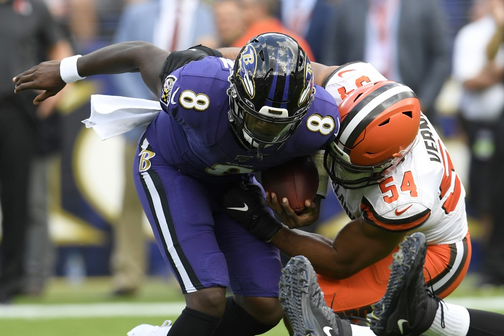 Cleveland Browns defensive end Olivier Vernon (54) sacks Baltimore Ravens quarterback Lamar Jackson (8) during the first half of an NFL football game ...