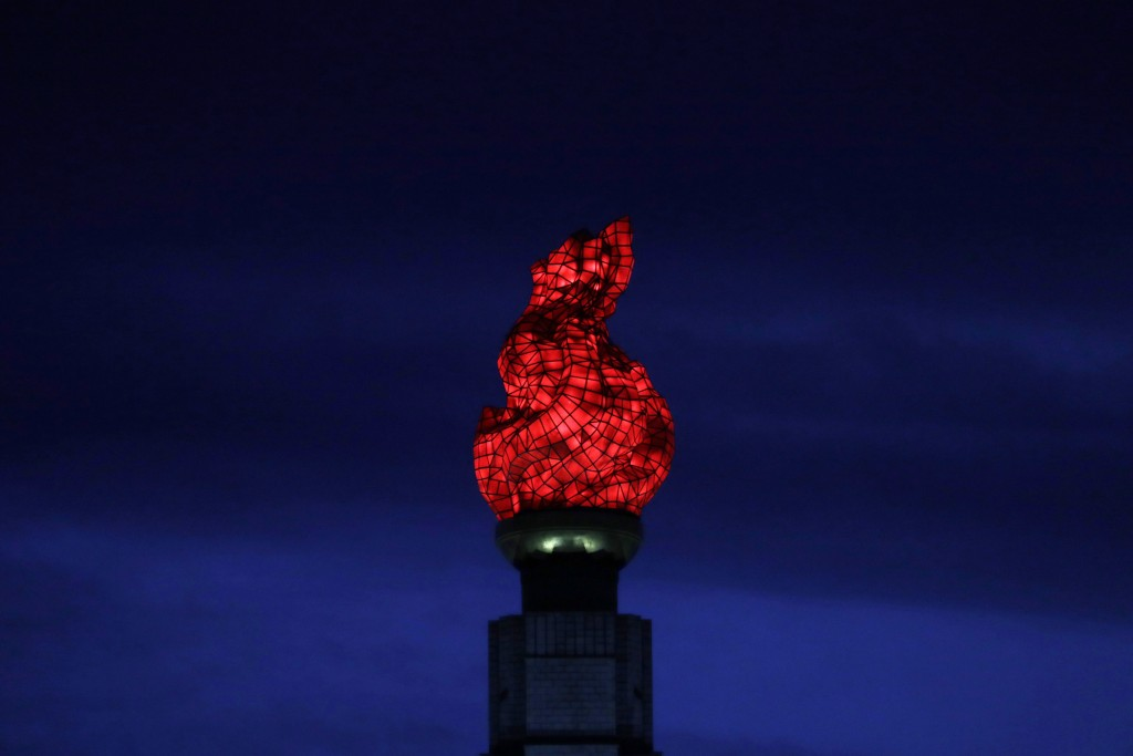 In this Sept. 15, 2018, photo, the Tower of Juche Idea is lit up in Pyongyang, North Korea. The word Juche is splashed across countless propaganda sig...