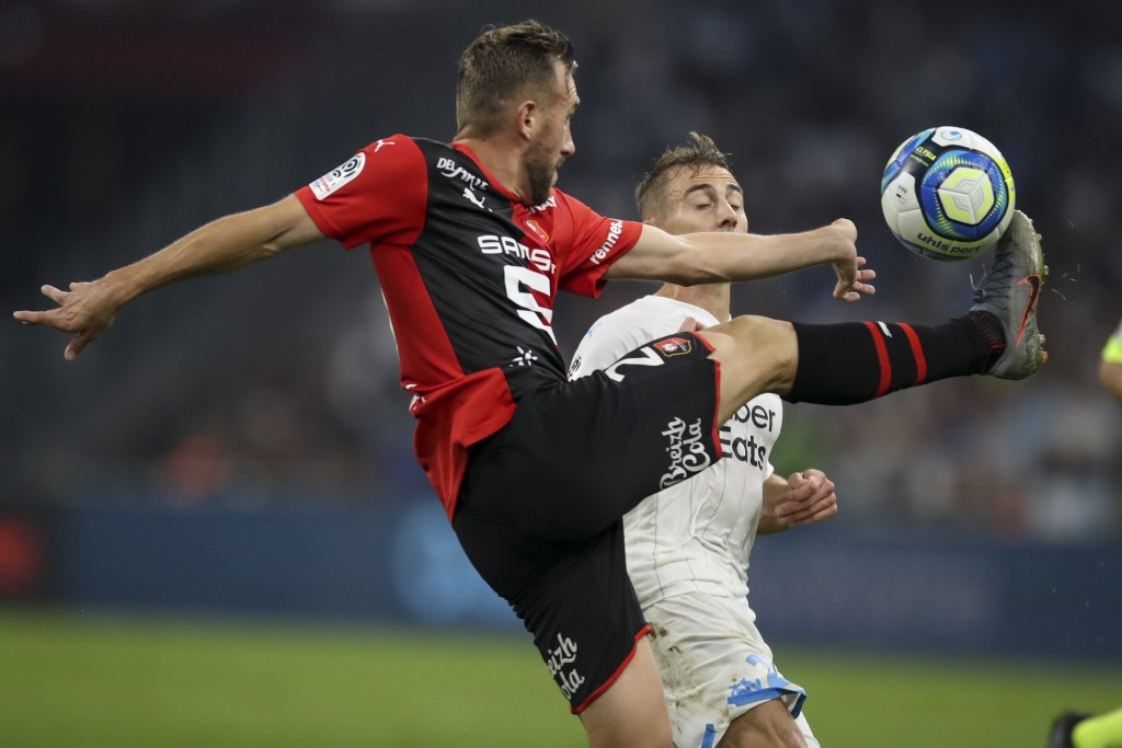 Rennes' Flavian Tait and Marseille's Valentin Rongier battle for the ball during the French League One soccer match between Marseille and Rennes at th...