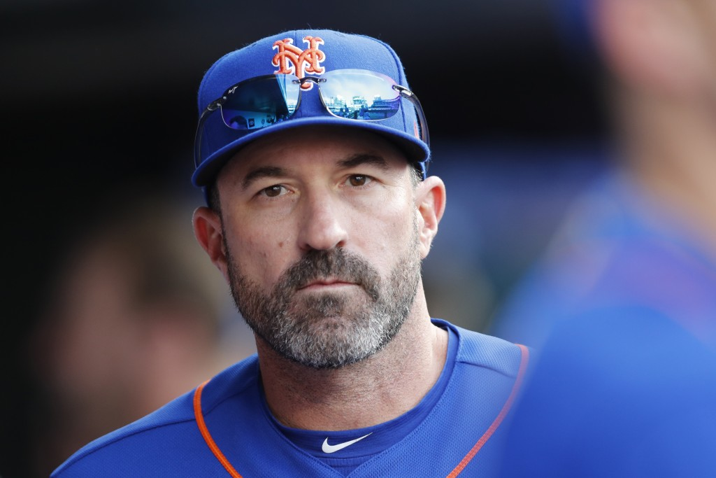 New York Mets manager Mickey Callaway looks out from the dugout during a baseball game against the Atlanta Braves, Sunday, Sept. 29, 2019, in New York...