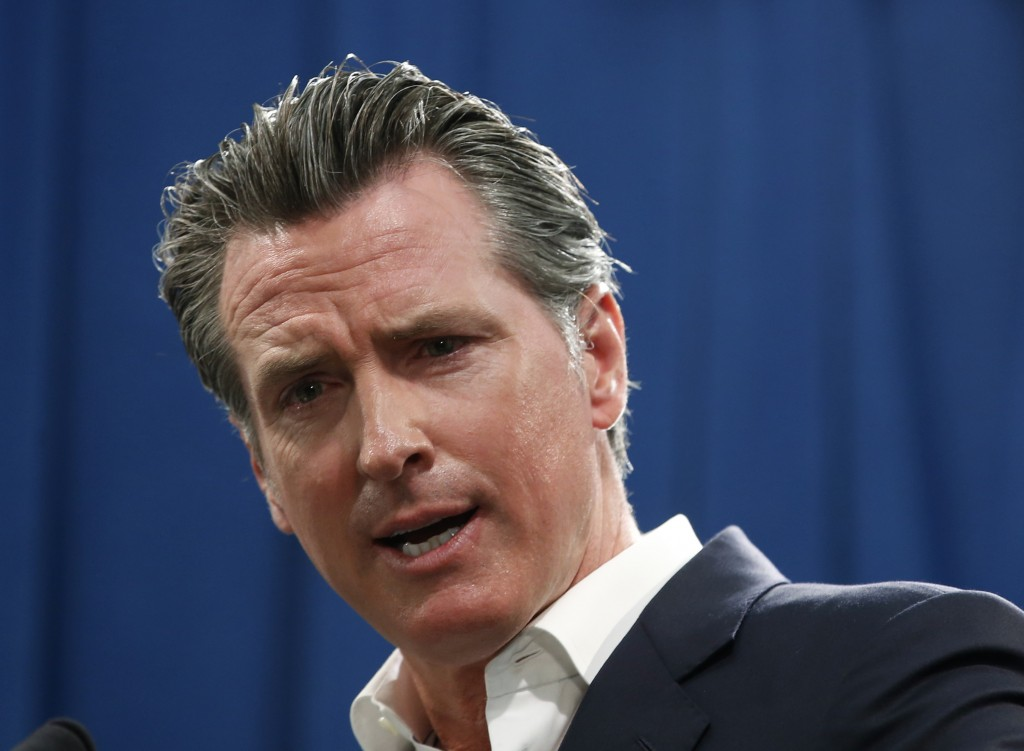 FILE - In this Sept. 16, 2019, file photo, Gov. Gavin Newsom answers a question during a news conference in Sacramento, Calif. Newsom announced Monday...