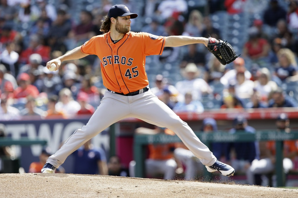 Houston Astros starting pitcher Gerrit Cole throws to a Los Angeles Angels batter during the first inning of a baseball game in Anaheim, Calif., Sunda...