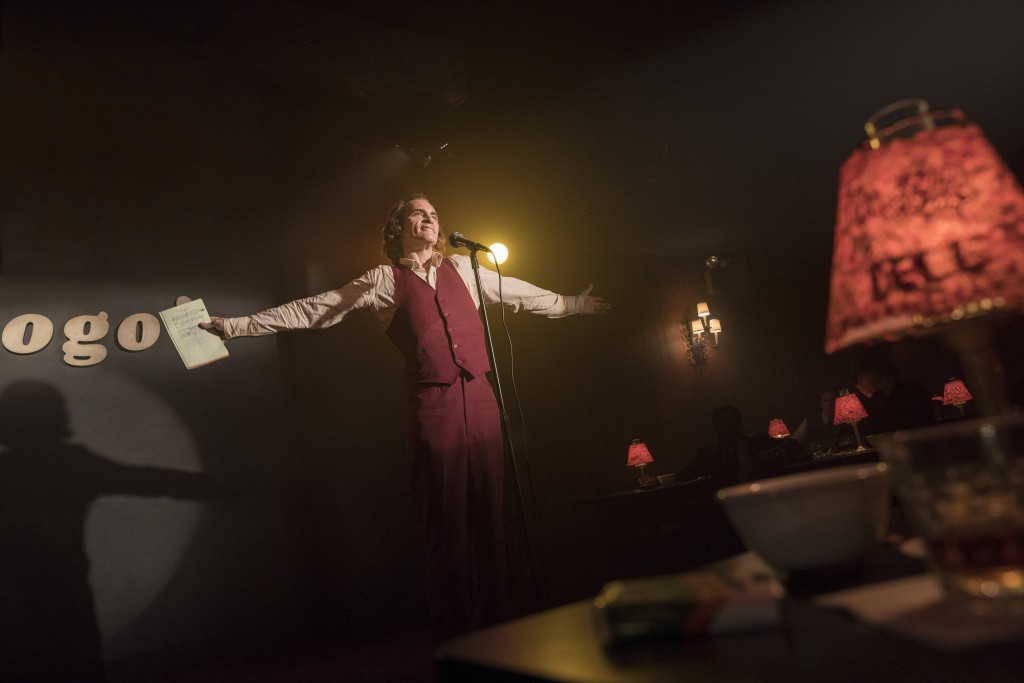 """This image released by Warner Bros. Pictures shows Joaquin Phoenix in a scene from """"Joker,"""" in theaters on Oct. 4.  (Niko Tavernise/Warner Bros. Pictu..."""