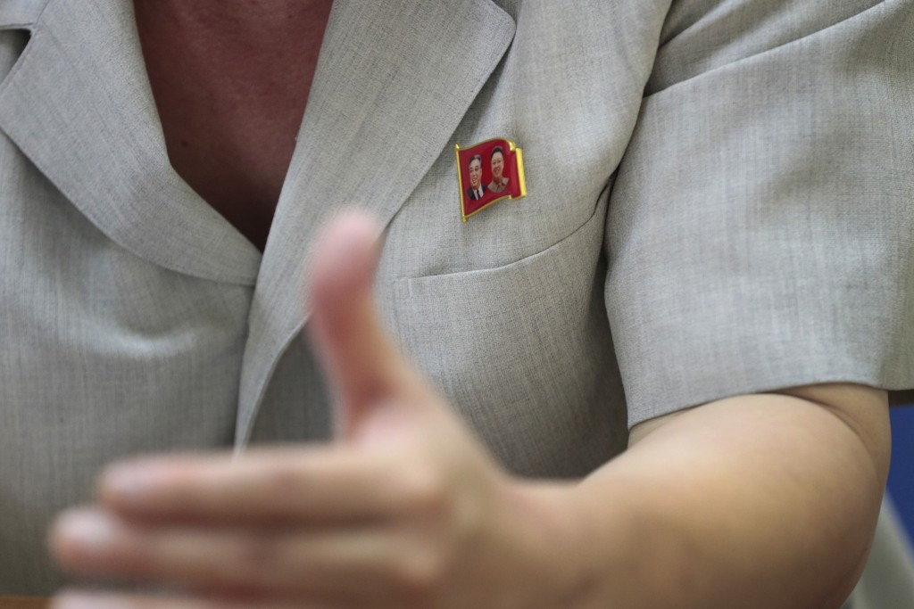 In this Sept. 12, 2019 photo, Kim Chang Kyong, Juche expert and who is also the head of North Korean Social Scientists Association, wears a pin of the...