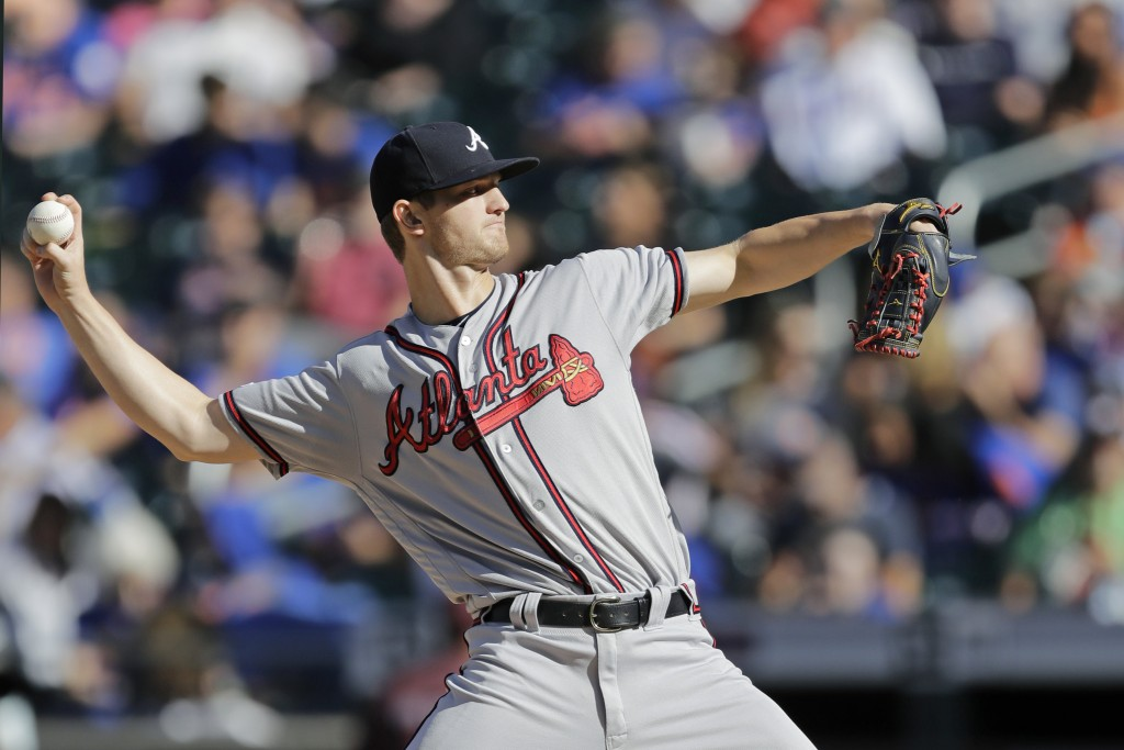 Atlanta Braves starting pitcher Mike Soroka winds up during the first inning of a baseball game against the New York Mets, Sunday, Sept. 29, 2019, in ...