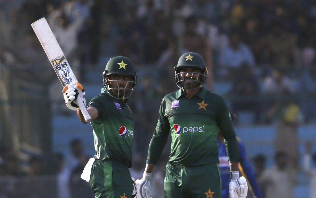 Babar Azam, left, acknowledges his fifty against Sri Lanka with Haris Sohail, in Karachi, Pakistan, Monday, Sept. 30, 2019. Pakistan play a second one...