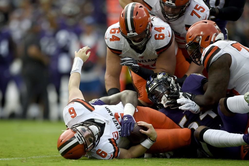 Cleveland Browns quarterback Baker Mayfield (6) is sacked by Baltimore Ravens linebacker Pernell McPhee during the first half of an NFL football game ...