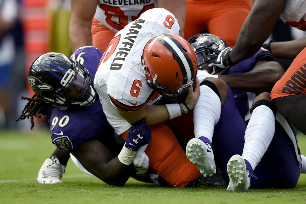 Baltimore Ravens linebacker Pernell McPhee (90) sacks Cleveland Browns quarterback Baker Mayfield (6) during the first half of an NFL football game Su...