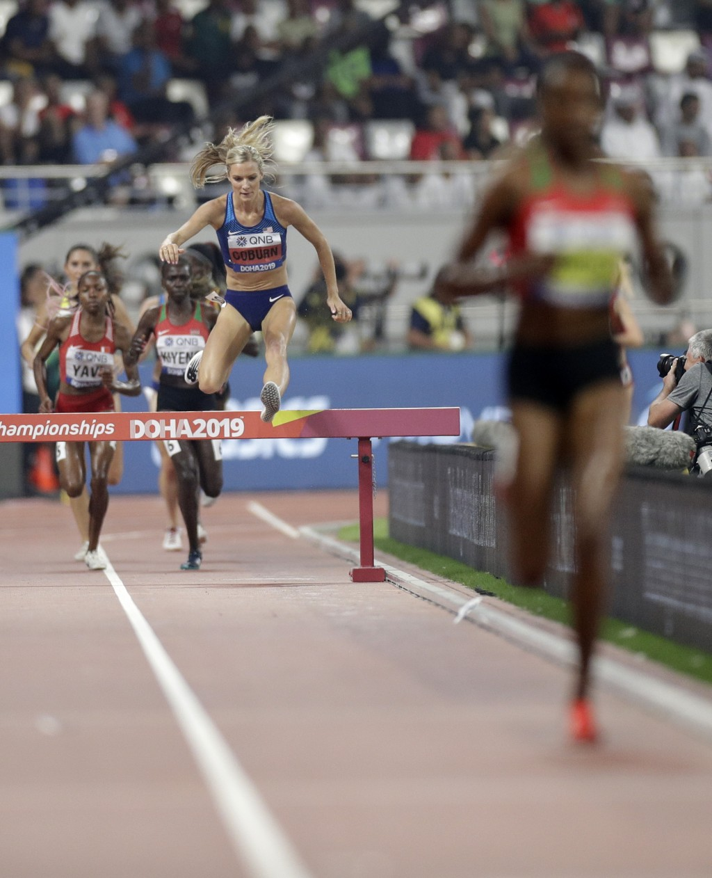 Emma Coburn, of the United States chases runaway leader Beatrice Chepkoech, of Kenya, the women's 3000 meter steeplechase final at the World Athletics...