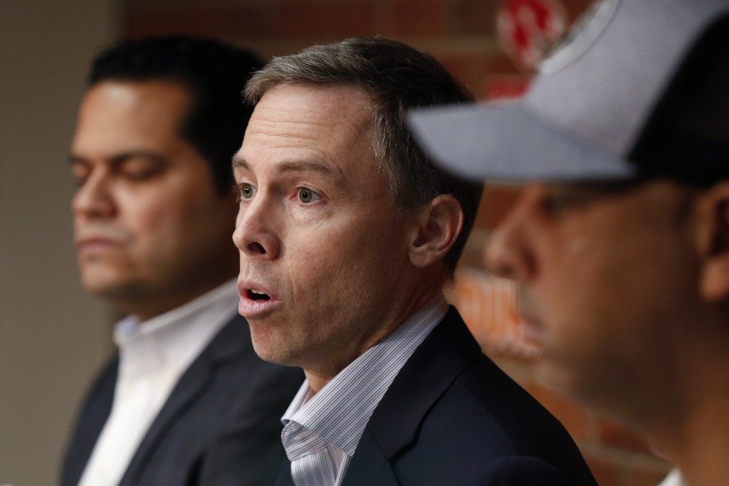 Boston Red Sox Assistant General Managers Brian O'Halloran, center, and Eddie Romero, left, and manager Alex Cora, right, speak with reporters during ...