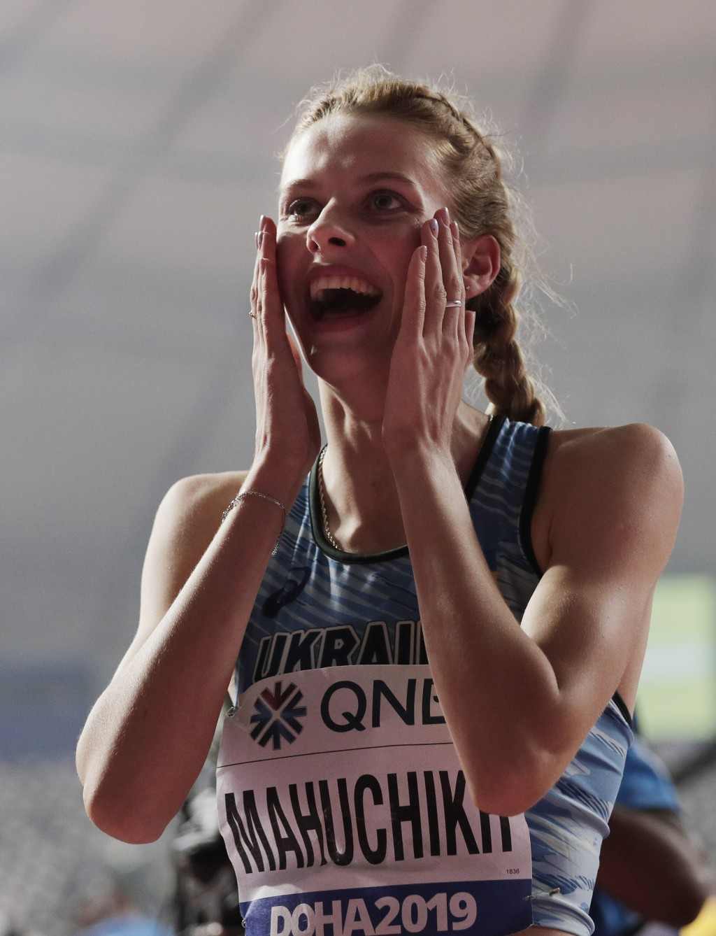 Yaroslava Mahuchikh, of Ukraine reacts after making a clearance in the women's high jump final at the World Athletics Championships in Doha, Qatar, Mo...