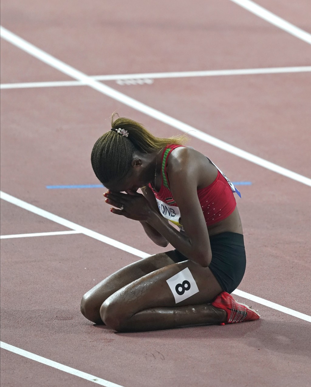 Beatrice Chepkoech, of Kenya, reacts after winning the the women's 3000 meter steeplechase final at the World Athletics Championships in Doha, Qatar, ...