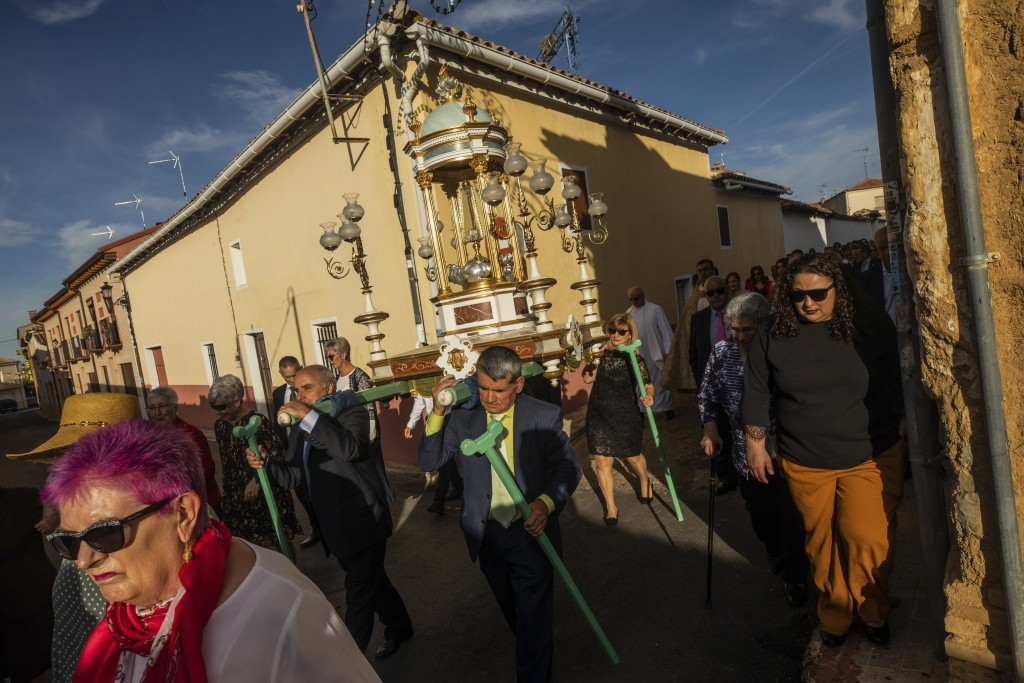 In this Saturday, Sept. 27, 2019 photo, villagers carry the relics of Saint Toribio during an afternoon procession in Mayorga, northwest Spain. The pr...