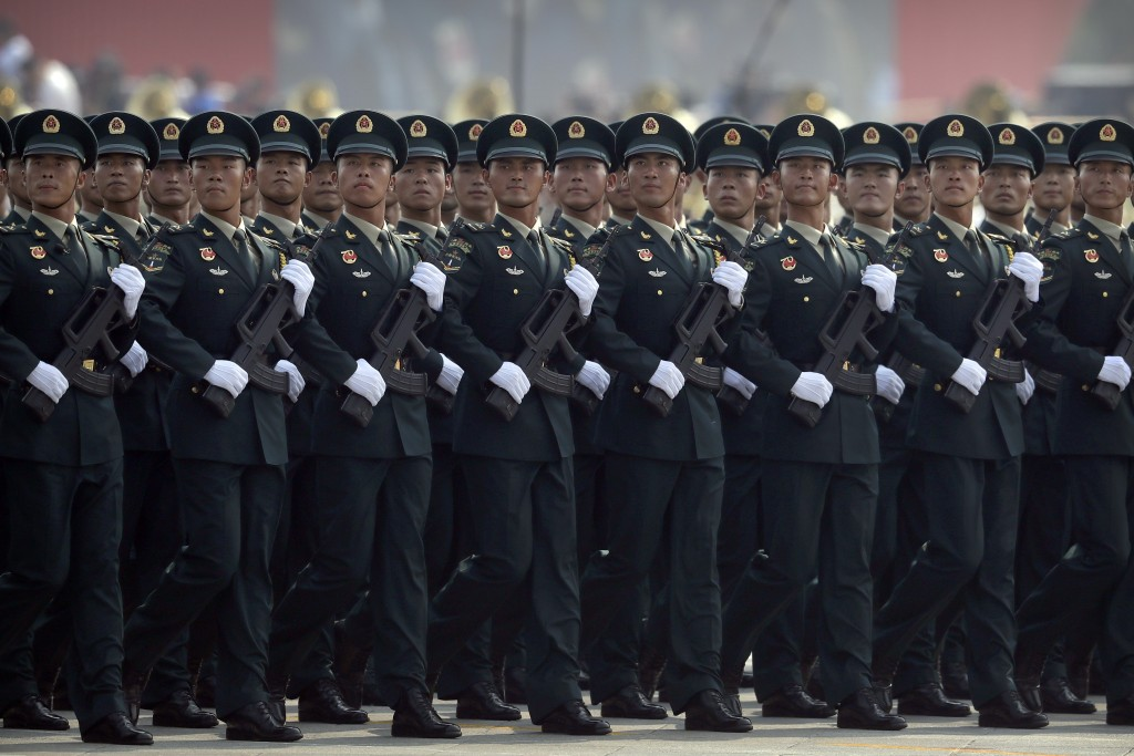 Members of China's People's Liberation Army (PLA) Rocket Force march in formation during a parade to commemorate the 70th anniversary of the founding ...