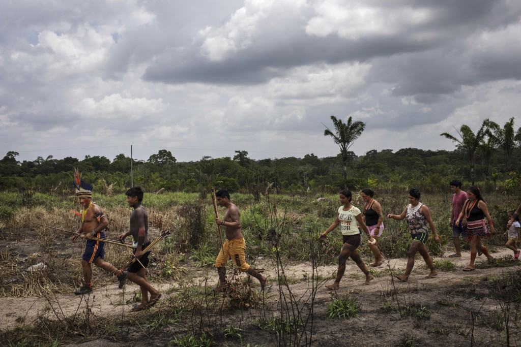In this Sept. 4, 2019 photo, Cajueiro cheiftain Sergio Muxi Tembe leads villagers to the second day of meetings among the Tembe tribes in the Alto Rio...