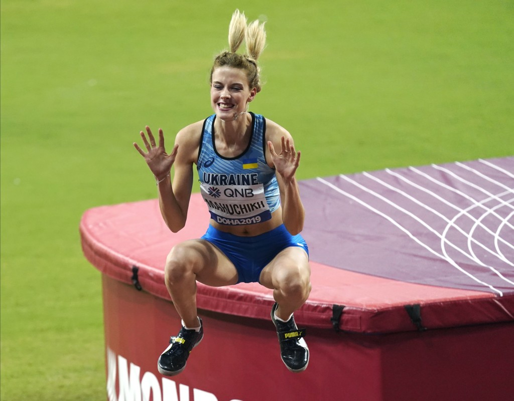Yaroslava Mahuchikh, of Ukraine, reacts after competing in the women's high jump final at the World Athletics Championships in Doha, Qatar, Monday, Se...