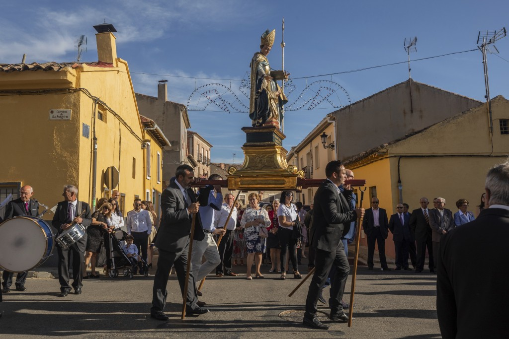 In this Saturday, Sept. 27, 2019 photo, villagers carry the carving of Saint Toribio during an afternoon procession in Mayorga, northwest Spain. The p...