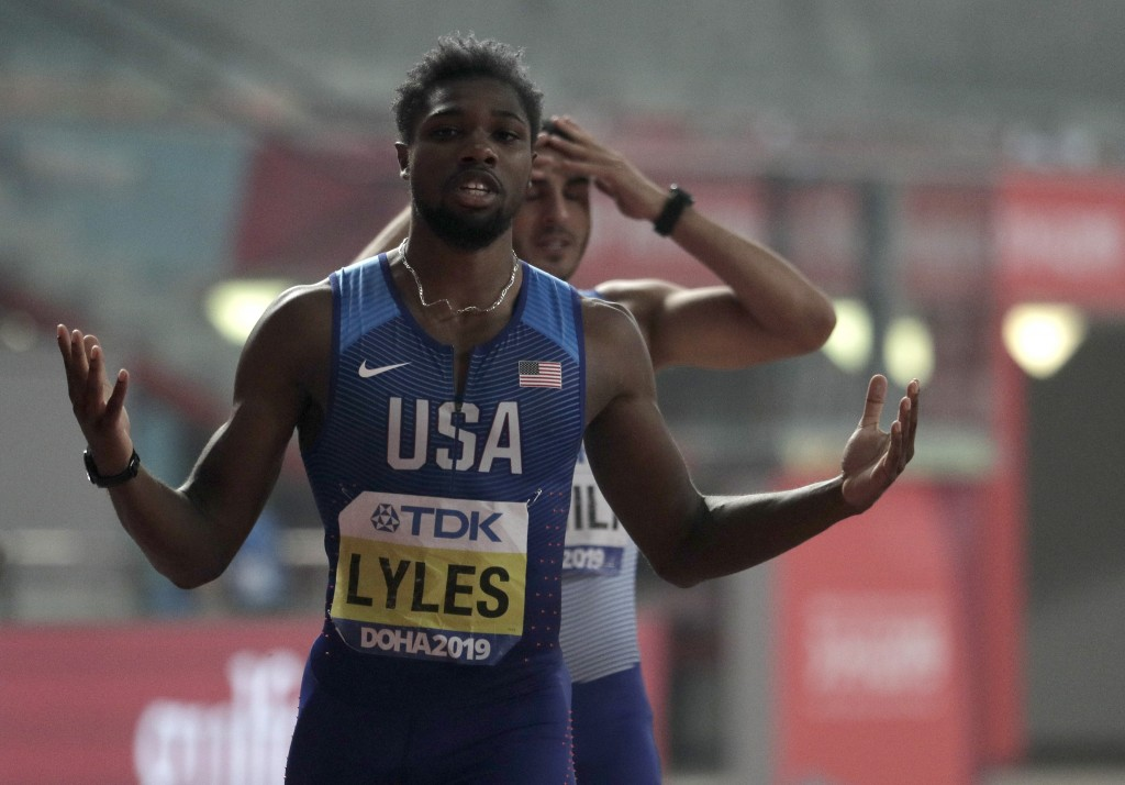 Noah Lyles of the U.S., celebrates winning the gold medal in the men's 200 meter final at the World Athletics Championships in Doha, Qatar, Tuesday, O...