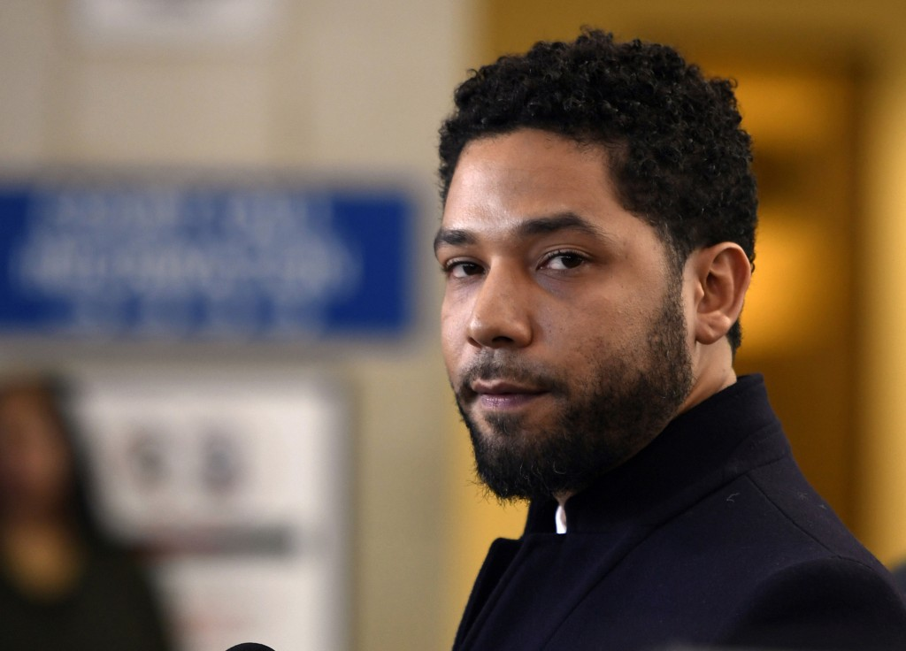 FILE - In this March 26, 2019, file photo, actor Jussie Smollett talks to the media before leaving Cook County Court after his charges were dropped, i