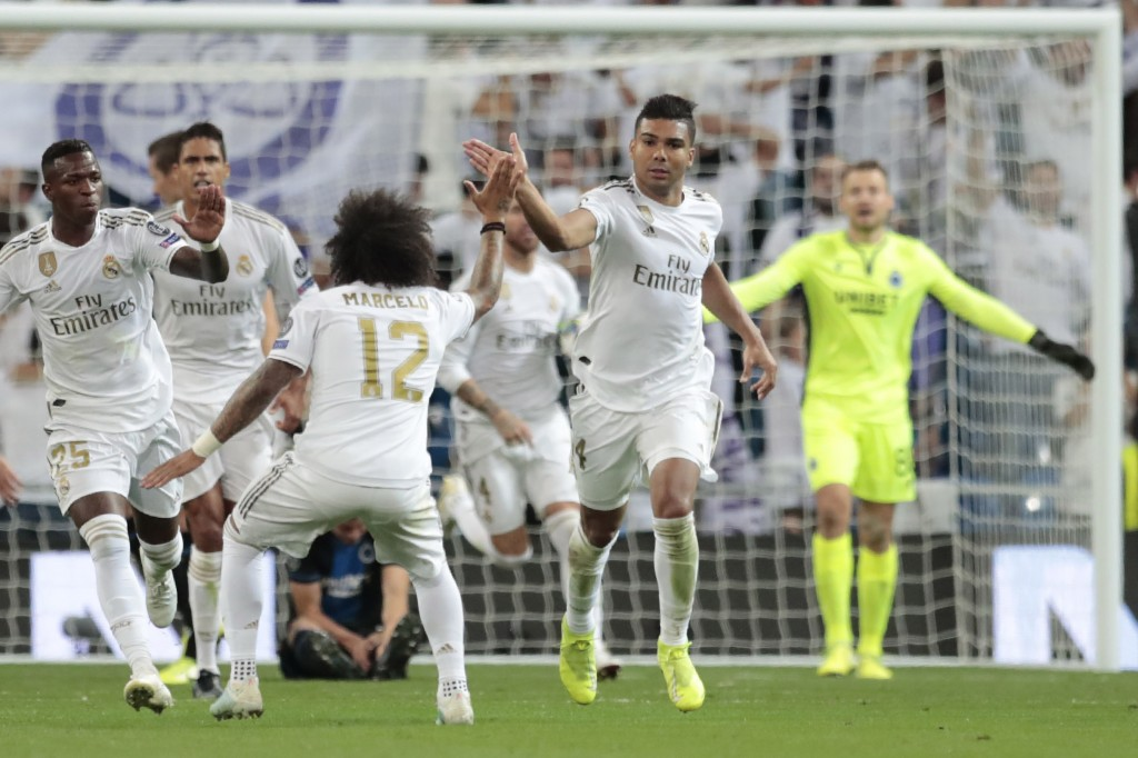 Real Madrid's Casemiro, right, celebrates his goal against Brugge during the Champions League group A soccer match between Real Madrid and Club Brugge