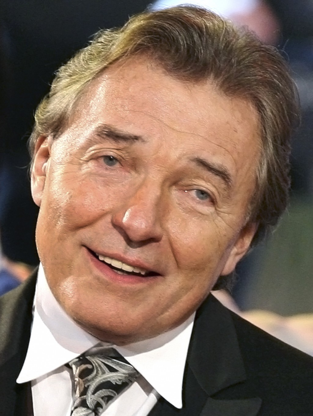 File--- Picture taken March 17, 2007 Czech singer Karel Gott performs during the dress rehearsal of a German TV show in Riesa, eastern Germany. Gott d...