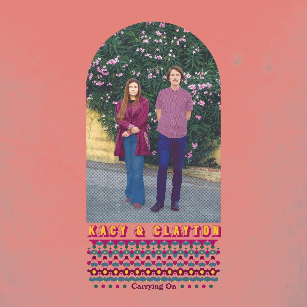 """This cover image released by New West Records shows """"Carrying On,"""" a release by Kacy and Clayton. (New West Records via AP)"""